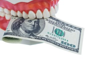 Mold representing dental implant cost.